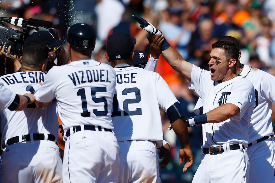 Aug 6, 2015; Detroit, MI, USA; Detroit Tigers second baseman Ian Kinsler (right) receives congratulations from teammates after he hits a walk off two run home run in the ninth inning against the Kansas City Royals at Comerica Park. Detroit won 8-6. Mandatory Credit: Rick Osentoski-USA TODAY Sports (Rick Osentoski/Rick Osentoski-USA TODAY Sports)