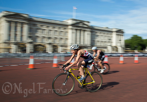15 SEP 2013 - LONDON, GBR - No time for sightseeing for  Loretta Sollars (GBR) of Great Britain as she passes Buckingham Palace during the ITU 2013 World Age Group Triathlon Championships in London, Great Britain. Sollars, a former British Elite, won the silver medal for the women's 50-54 age group category (PHOTO COPYRIGHT © 2013 NIGEL FARROW, ALL RIGHTS RESERVED) (NIGEL FARROW/COPYRIGHT © 2013 NIGEL FARROW : www.nigelfarrow.com)
