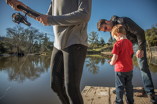 Portland resident Tyler Chester instructs his son, Caden, on the fine art of fishing at the home of his sister on an unusually warm January afternoon in the hills above Calistoga, CA. (Clark James Mishler)