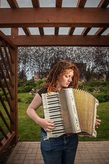Leah Moraes pactices her accordian at the Rose Garden on the Delaney Park Strip, Anchorage  leahnmoraes@gmail.com (Clark James Mishler)
