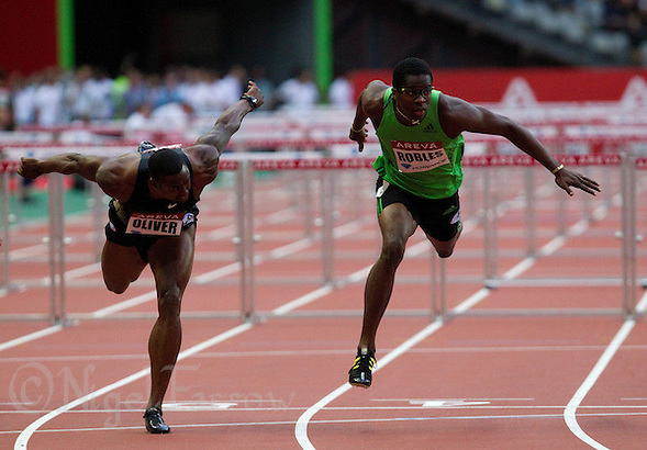 08 JUL 2011 - PARIS, FRA - Dayron Robles (right) beats David Oliver (left) in the men's 110m hurdles at the Meeting Areva round of the Samsung Diamond League (PHOTO (C) NIGEL FARROW) (NIGEL FARROW/(C) 2011 NIGEL FARROW)