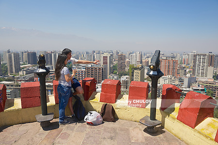 SANTIAGO, CHILE - OCTOBER 17, 2013: Unidentified young couple enjoy the view of Santiago city from the Santa Lucia hill fortress in Santiago, Chile. (Dmitry Chulov)