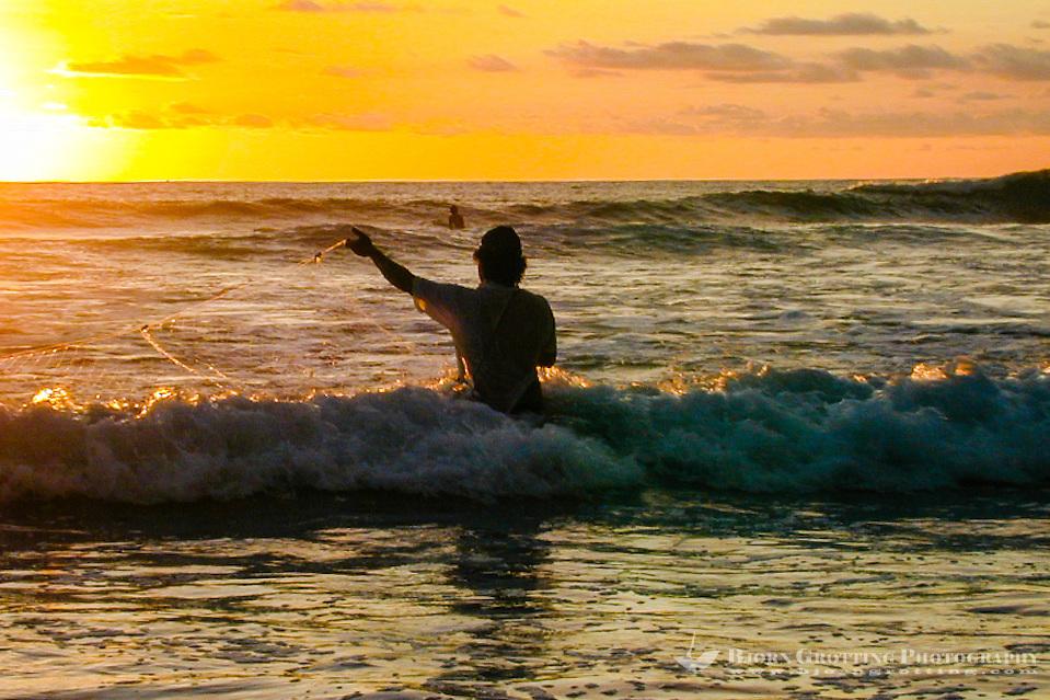 Bali, Badung, Kuta. Kuta Beach just before sunset. A fisherman tries his luck. (Photo Bjorn Grotting)