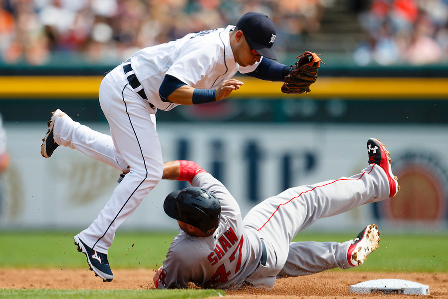 Aug 9, 2015; Detroit, MI, USA; Detroit Tigers shortstop Jose Iglesias (1) leaps over Boston Red Sox first baseman Travis Shaw (47) as he slides into second base in the second inning at Comerica Park. Mandatory Credit: Rick Osentoski-USA TODAY Sports (Rick Osentoski/Rick Osentoski-USA TODAY Sports)