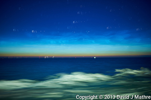Noctilucent Clouds Over the Baltic Sea. From my cabin on the MV Explorer while traveling from Stockholm to Copenhagen. Composite of 33 images taken with a Nikon D4 camera and 28 mm f/1.8 lens (ISO 800, 28 mm, f/1.8, 1 sec). Raw image processed with Capture One Pro, and Photoshop CC (statistics, maximum). (David J Mathre)