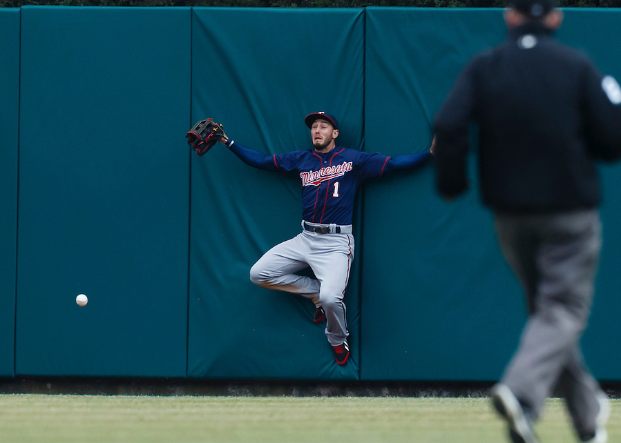Apr 6, 2015; Detroit, MI, USA; Minnesota Twins center fielder Jordan Schafer (1) leaps onto the center field wall in an attempt to catch a ball hit by Detroit Tigers left fielder Yoenis Cespedes (not pictured) for a triple in the sixth inning at Comerica Park. Mandatory Credit: Rick Osentoski-USA TODAY Sports (Rick Osentoski/Rick Osentoski-USA TODAY Sports)