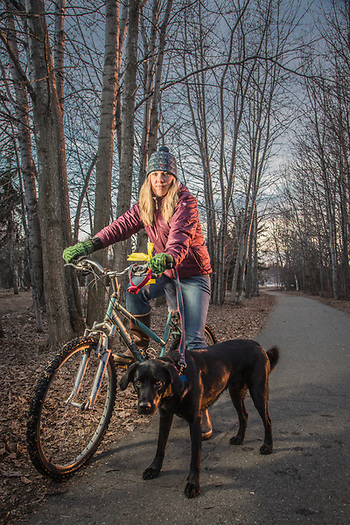 Allison Phillips with her dog, Trig, on the Tony Knowles Coastal Trail near Westchester Lagoon, Anchorage (Clark James Mishler)