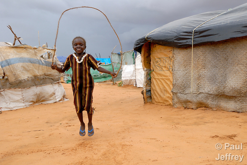 A girl skips rope in the Dereig Camp for internally displaced persons, one of many such settlements for people displaced by the violence in Darfur. (Paul Jeffrey)