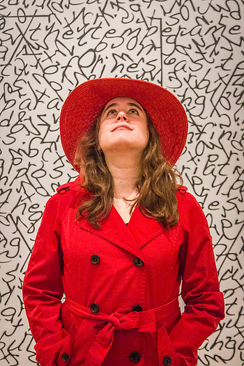 "Ariel Isaacs, in costume as Carmen Sandiego, stands in front of ""Lines as Vocabulary"" by Will Ashford at the Sofie Gallery in Calsitoga. (Clark James Mishler)"