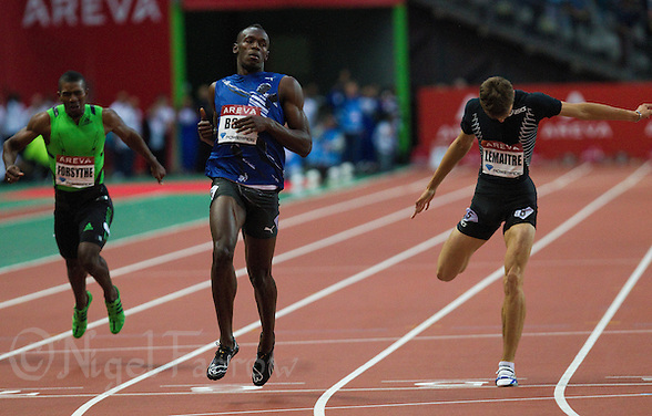 08 JUL 2011 - PARIS, FRA - Usain Bolt wins the men's 200m race at the Meeting Areva round of the Samsung Diamond League ahead of Mario Forsythe (left) and Christophe Lemaitre (right) .(PHOTO (C) NIGEL FARROW) (NIGEL FARROW/(C) 2011 NIGEL FARROW)