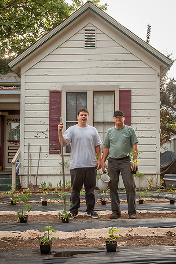 "Tony McBeardsley and his son, Will, in front of their house in Calistoga  ""We're a little late, but we are finally putting in our summer garden...this year we decided to convert the front lawn."" (Clark James Mishler)"
