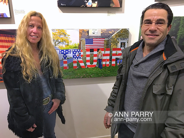 Huntington, New York, USA. March 5, 2017. Eileen Fuscaldo and her husband, next to 2016 photo of Eileen, at Opening Reception for