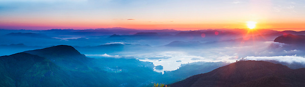 Panoramic photo of the view from Adams Peak (Sri Pada) at sunrise, Sri Lanka, Asia. This is a panoramic photo of the view from Adams Peak (Sri Pada) at sunrise, Sri Lanka, Asia. Reaching the summit of Adams Peak for sunrise requires a 2am start, but is well worth it for the stunning, misty, panoramic view from the summit.
