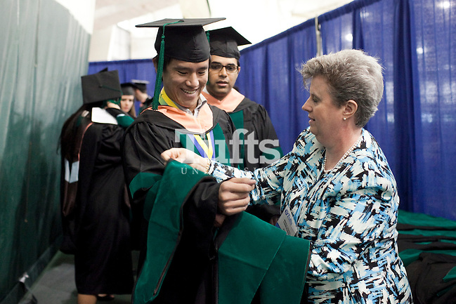 05/22/2011- Medford, Mass. - Matthew Dong, M11, receives his hood during commencement for the Tufts University School of Medicine on May 22, 2011. (Kelvin Ma/Tufts University) (Kelvin Ma/Tufts University)