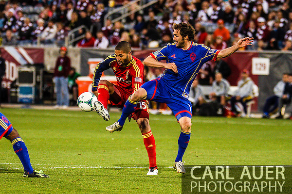 April 6th, 2013 - Real Salt Lake forward Álvaro Saborío (15) and Colorado Rapids midfielder Brian Mullan (11) fight for the ball in front of the goal during second half action of the MLS match between Real Salt Lake and the Colorado Rapids at Dick's Sporting Goods Park in Commerce City, CO (Carl Auer/Newsport)