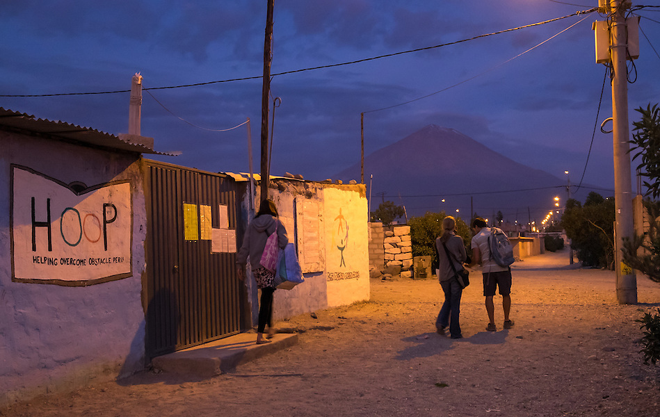 AREQUIPA, PERU - APRIL 7, 2014: Volunteers walking out after a day of teaching in the community of Flora Tristan for HOOP Peru. HOOP Peru is a NGO fully committed to breaking the cycle of poverty by empowering the Flora Tristan families through enhancing their education. (Daniel Korzeniewski)