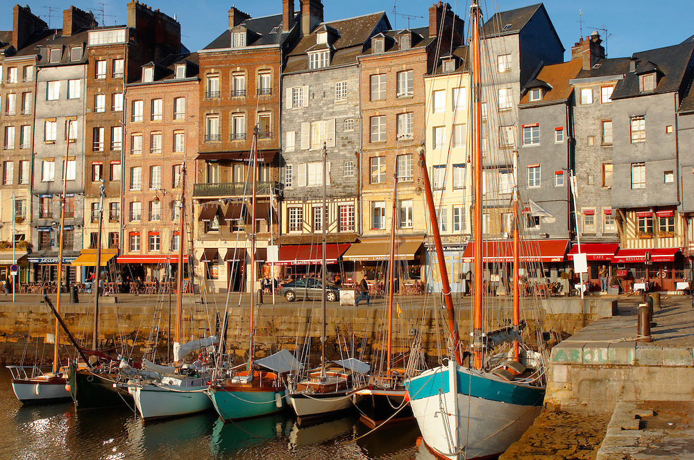 photo of Harbour side restauarant - La Bisquine . Honfleur, Normandy, France. (By Travel photographer Paul Williams. http://funkystockstockphotos.com)