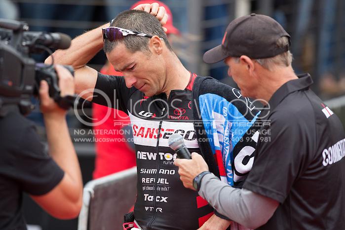 Craig Alexander (AUS), March 23, 2014 - Ironman Triathlon : Ironman Melbourne Race, Run Course Run Course Race Finish, St Kilda, Melbourne, Victoria, Australia. Credit: Lucas Wroe (Lucas Wroe)