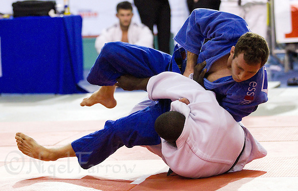 27 MAR 2011 - SHEFFIELD, GBR - Andrew Burns (blue) gets the better of his opponent in the men's under 90kg category at the English Senior Open Judo Championships (PHOTO (C) NIGEL FARROW) (NIGEL FARROW/(C) 2011 NIGEL FARROW)