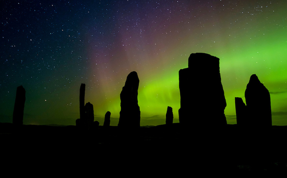 LEWIS AND HARRIS, SCOTLAND - CIRCA APRIL 2016: Aurora Borealis also known as Northern Lights over the famous Callanish Stones in Outer Islands of Lewis and Harris in Scotland. (Daniel Korzeniewski)