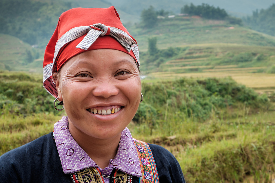 SAPA, VIETNAM - CIRCA SEPTEMBER 2014:  Young woman from the Red Dao minority smiling in Ta Phin Village near Sapa, north Vietnam. (Daniel Korzeniewski)