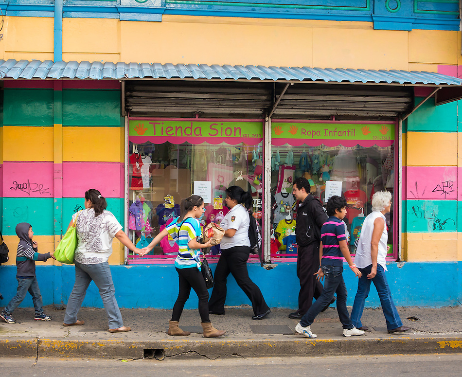 SAN JOSE, COSTA RICA - CIRCA AUGUST 2012: Typical street scene with locals, circa 2012 in San Jose, a very popular tourist destination with 2.2 million foreign visitors a year. (Daniel Korzeniewski)