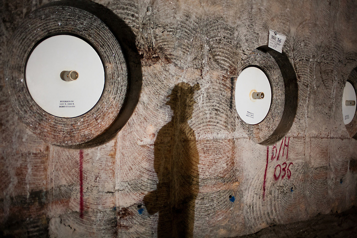A shadow falls on a wall containing stored radioactive waste 2150 ft underground inside The Waste Isolation Pilot Plant in Eddy County. WIPP received $172 million as part of the Recovery and Reinvestment Act accelerate nuclear waste cleanup. (Steven St. John)
