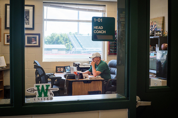 Waxahachie, Texas - September 4, 2015: Jon Kitna, Head Football Coach, poses for a portrait in his office at Waxahachie High School in Waxahachie, Texas. (Darren Carroll for ESPN) (Darren Carroll)