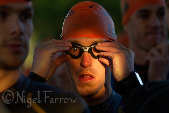 15 SEP 2013 - LONDON, GBR - A competitor waits for the start of the swim at the ITU 2013 World Age Group Standard Distance Triathlon Championships in Hyde Park in London, Great Britain (PHOTO COPYRIGHT © 2013 NIGEL FARROW, ALL RIGHTS RESERVED) (NIGEL FARROW/COPYRIGHT © 2013 NIGEL FARROW : www.nigelfarrow.com)