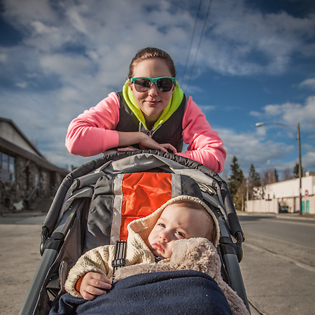 "Jake Tuker and Amanda Celia with their son, Noah, on E Street and 13 Avenue, Anchorage.  ""Our dream is to open a restaurant in up-state New York.  Jake will run the businss and I will cook.""  jacob.tucker09@gmail.com (© Clark James Mishler)"