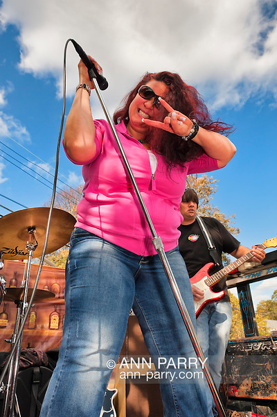 "Making ""Rock on"" ""horns"" (corna) hand gesture is Blues singer Sweet Suzi Smith, performing with guitarist John Puglisi of ""Sweet Suzi and Sugafixx"" at Merrick Street Fair in Merrick, New York, USA, on October 22, 2011 (Ann Parry/Ann Parry, Ann-Parry.com)"