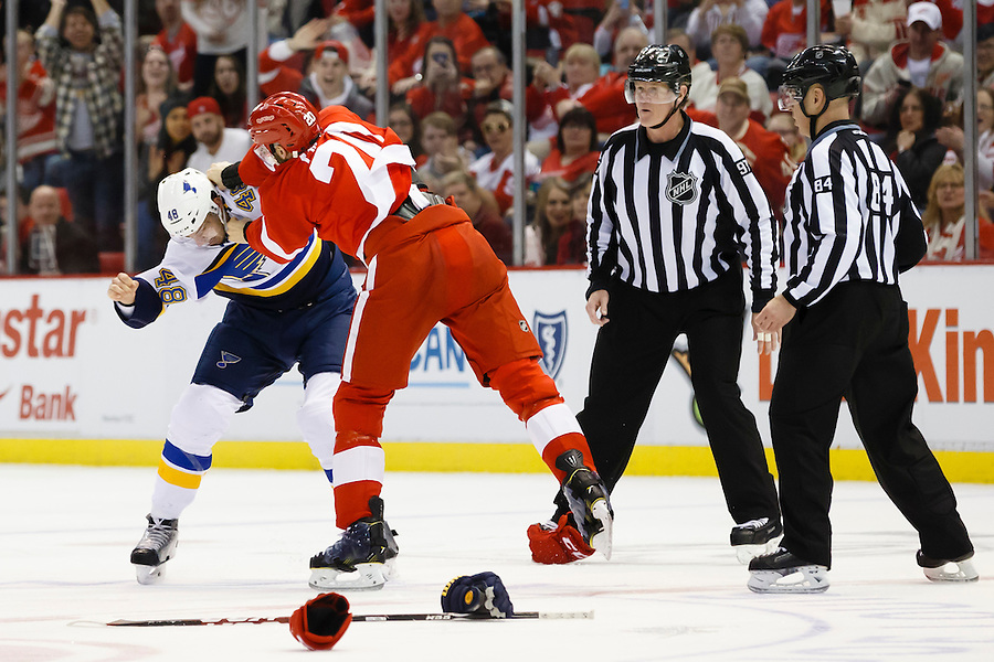 Mar 22, 2015; Detroit, MI, USA; St. Louis Blues defenseman Petteri Lindbohm (48) and Detroit Red Wings left wing Drew Miller (20) fight in the third period at Joe Louis Arena. Detroit won 2-1 in overtime. Mandatory Credit: Rick Osentoski-USA TODAY Sports (Rick Osentoski/Rick Osentoski-USA TODAY Sports)