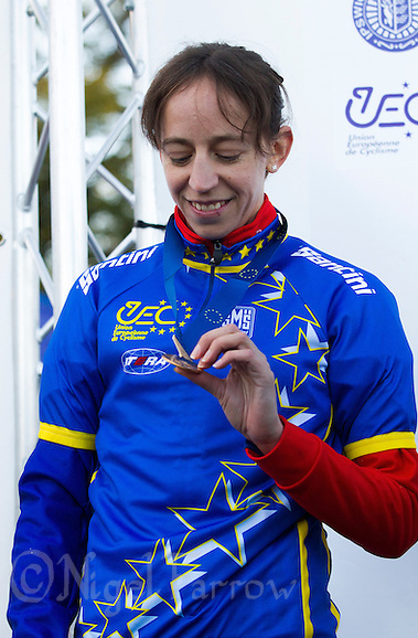 03 NOV 2012 - IPSWICH, GBR - Helen Wyman (GBR) of Great Britain looks at her medal after winning the Elite Women's European Cyclo-Cross Championships in Chantry Park, Ipswich, Suffolk, Great Britain (PHOTO (C) 2012 NIGEL FARROW) (NIGEL FARROW/(C) 2012 NIGEL FARROW)