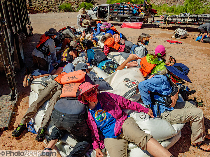 On the last of 16 days boating together for 226 miles, our group lay down on the job of raft deflation, at Diamond Creek on the Hualapai Indian Reservation, Arizona, USA. During this pandemic trip (April 3-18, 2021), masks were required during the initial meeting in Flagstaff, for bus rides, for initial embarkation at Lees Ferry, for serving lines at all meals, and for final disembarkation at Diamond Creek. Otherwise, our healthy outdoor raft trip was unencumbered by facial coverings. For this photo's licensing options, please inquire at PhotoSeek.com. (© Tom Dempsey / PhotoSeek.com)