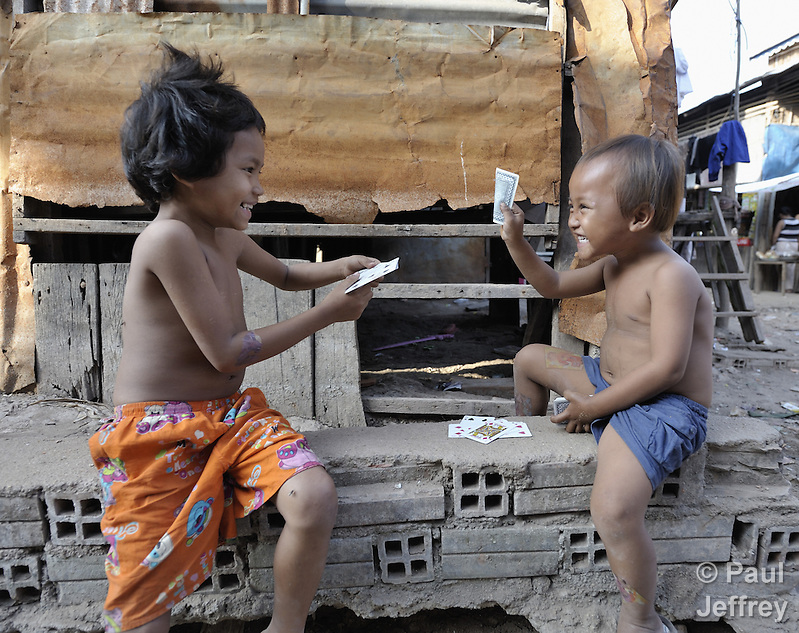 Boys playing cards in the Chamroen neighborhood of Phnom Penh, Cambodia. (Paul Jeffrey)