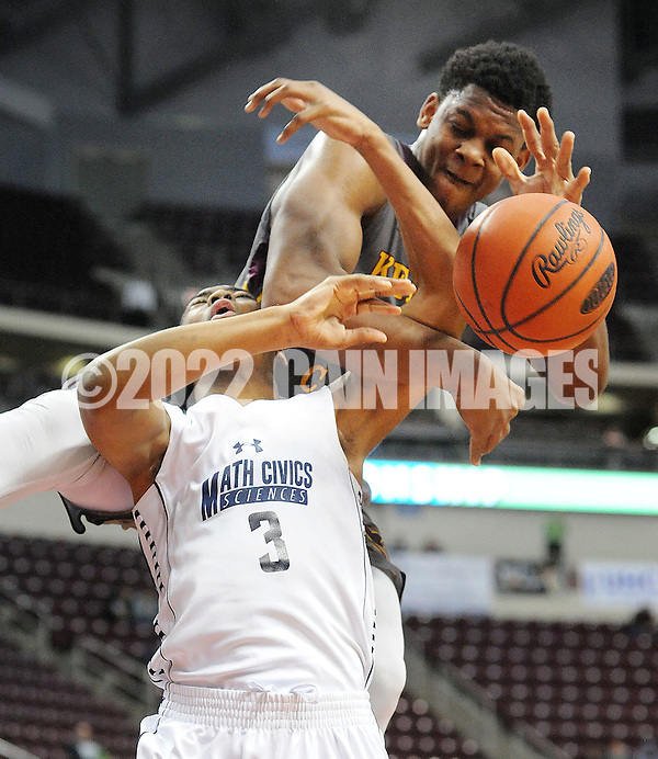 SMATH19P Kennedy Catholic's Sagaba Konate #50 lands on top of Math, Civics and Sciences Malik Archer #3 in the first quarter of the boys basketball PIAA Class A state championship game Friday March 18, 2016 at the Giant Center in Hershey, Pennsylvania. (WILLIAM THOMAS CAIN/For The Inquirer) (William Thomas Cain/Cain Images)