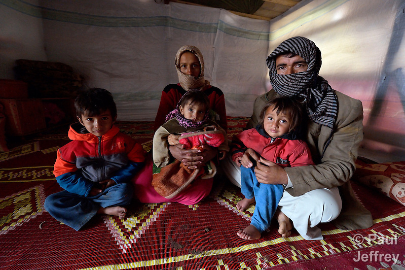 "This refugee family from Syria, whose members asked not to be named because of fears about their security should they return to their home country, live in a rented ""tent""--made from a billboard canvas--in the village of Jeb Jennine, in Lebanon's Bekaa Valley. They and other refugee families in the area are being assisted by International Orthodox Christian Charities and other members of the ACT Alliance. (Paul Jeffrey)"
