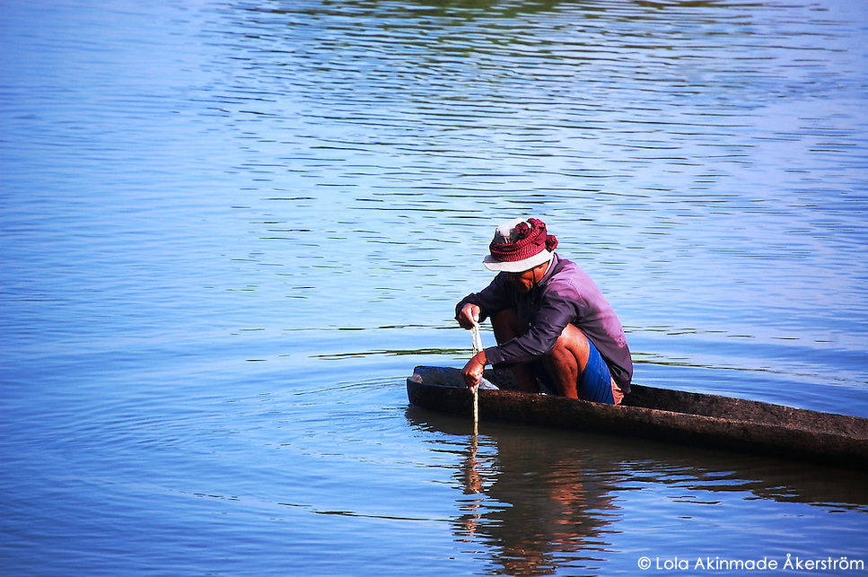 Postcard: Fisherman and ripples in a lake – Cambodia