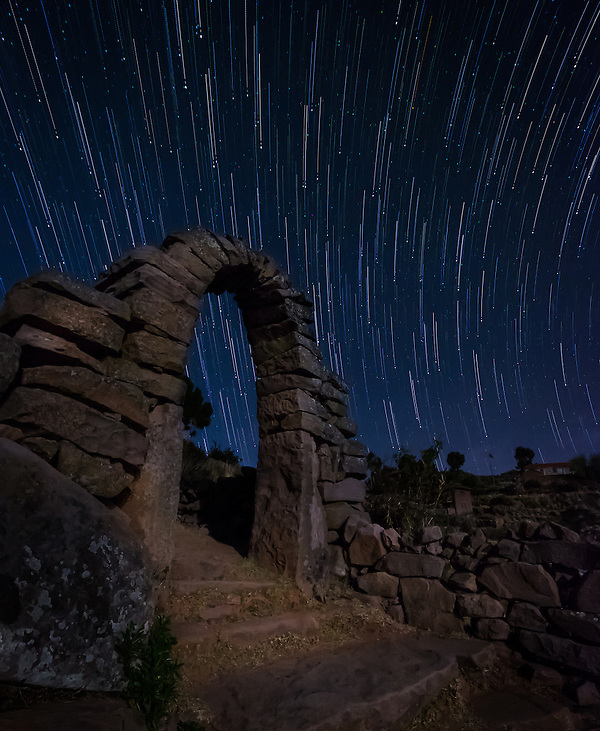 PUNO, PERU - CIRCA OCTOBER 2015: Star trails over typical arch of the Island of Taquile in Lake Titicaca. (Daniel Korzeniewski)