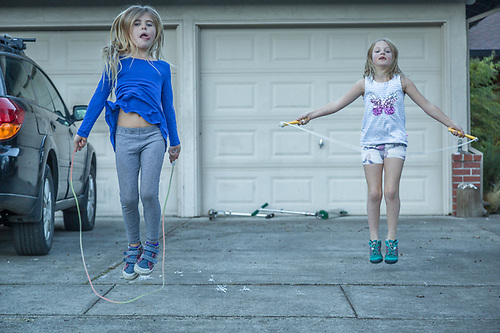 Ella Fitzpatrick (right) Jumpropes in front of her house with her Friend Lucia. (Clark James Mishler)