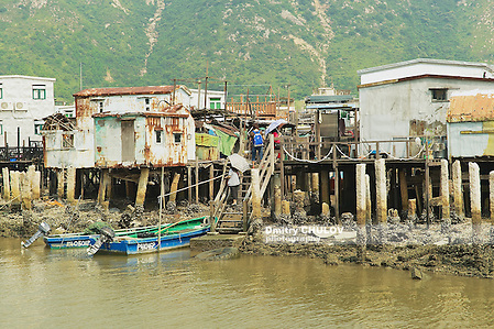 HONG KONG, CHINA - SEPTEMBER 15, 2012: Exterior of the Tai O fishermen village with stilt houses and motorboats in Hong Kong, China. Tai O is a famous tourist destination in Hong Kong. (Dmitry Chulov)