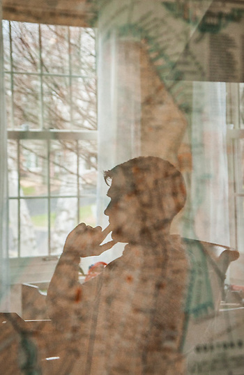 Reflection of Conor Green in his livingroom in Edina, Minnesota (© Clark James Mishler)