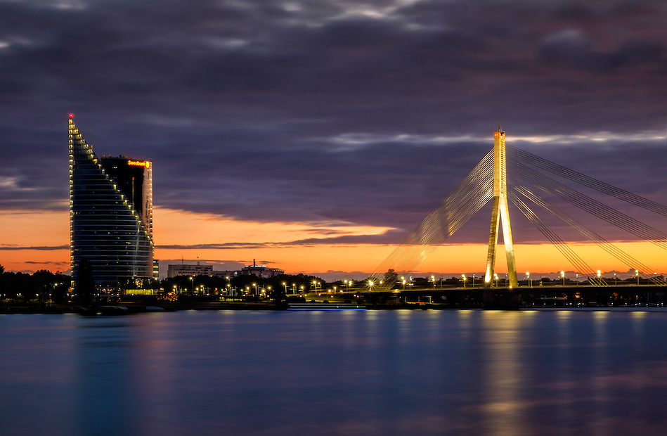 RIGA, LATVIA - CIRCA MAY 2014: Vansu Bridge over the Daugava river at night in  Riga. (Daniel Korzeniewski)