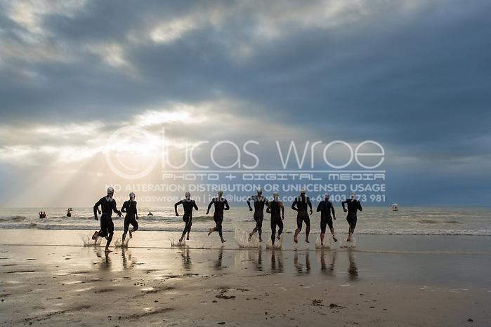 Pro Male field start the race and enter the water, June 1, 2014 - TRIATHLON : Coral Coast 5150 Triathlon, Cairns Airport Adventure Festival, Four Mile Beach, Port Douglas, Queensland, Australia. Credit: Lucas Wroe (Lucas Wroe)