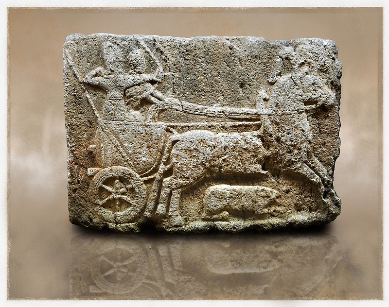 Picture & image of a Neo-Hittite orthostat with a chariot Releif sculpture from Karkamis,, Turkey. Ancora Archaeological Museum. The Cahiot is pulled by horses with plumed headresses. One man os about to shoot an arrow from his bow, the other man is driving the cahriot. Below the horse is a animal cowering. 4 (Paul E Williams)
