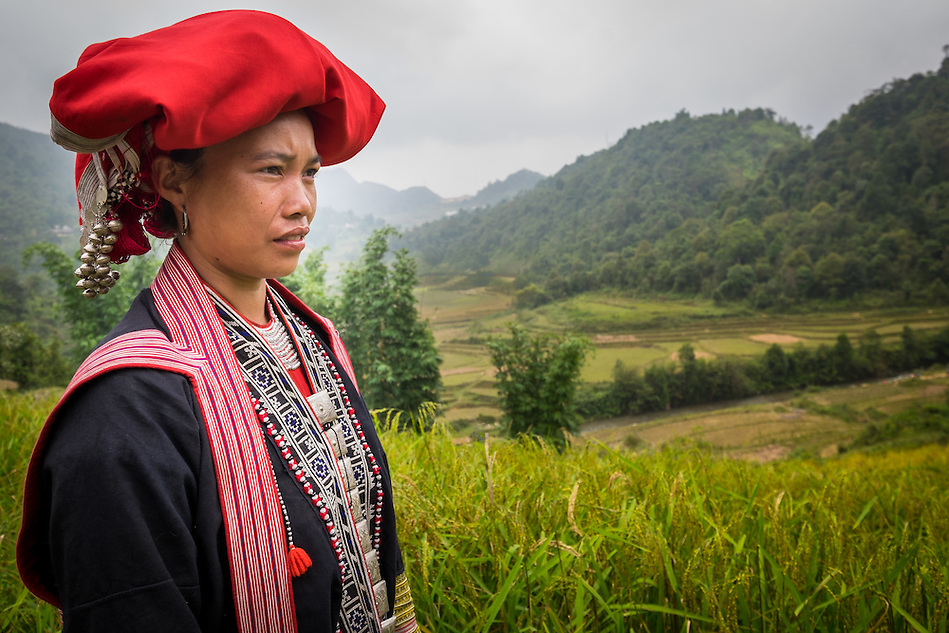 SAPA, VIETNAM - CIRCA SEPTEMBER 2014:  Young woman from the Red Dao minority on the rice fields in Ta Phin Village near Sapa, north Vietnam. (Daniel Korzeniewski)
