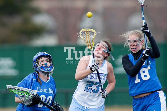 03/10/2012- Medford, Mass. - Tufts defender Meg Boland, A13, tracks a loose ball in front of the Hamilton goal in Tufts 8-7 season opening win over Hamilton on Mar. 10, 2012. (Kelvin Ma/Tufts University)