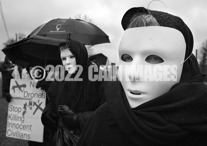 HORSHAM, PA - MARCH 29:  Marge Van Cleef (R) along with members of Coalition for Peace Action protest the Horsham Drone Command Center to protest March 29, 2014 in Horsham, Pennsylvania. The mask represents civilians that have been killed by drone strikes. (Photo by William Thomas Cain/Cain Images) (William Thomas Cain)