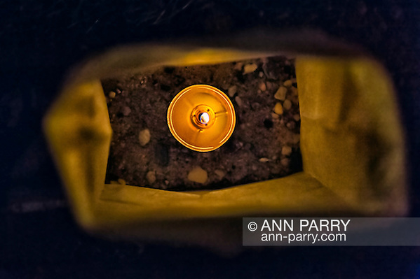 Sept. 11, 2012 - Merrick, New York, U.S. - After night fall, this is the inside view of one of 500 Luminary Bags distributed among the 215 Wenshaw Park homes on the 11th Anniversary of 9/11, by Wenshaw Park Civic Association, Long Island, with over $500 already raised for Twin Towers Orphan Fund. The tea candle in each bag will self-extinguish overnight, and volunteers will collect the bags on 9/12. (Ann Parry/-)