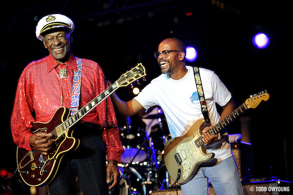 Chuck Berry and son, Charles Berry Jr., performing at Kiener Plaza in St. Louis during a rally concert for St. Louis's bid for the Democratic National Convention in 2010. (© Todd Owyoung)
